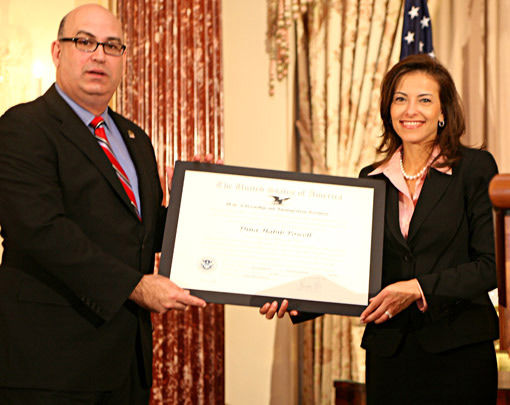 "USCIS_Director_Emilio_T._González_presents_Assistant_Secretary_of_State_Dina_Powell_with_the_""Outstanding_American_by_Choice""_recognition_in_Washington__DC__Apr._23__2007"