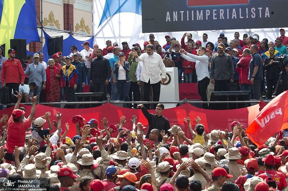 10787150-6789761-Venezuela_s_President_Nicolas_Maduro_acknowledges_supporters_dur-a-78_1552192100625
