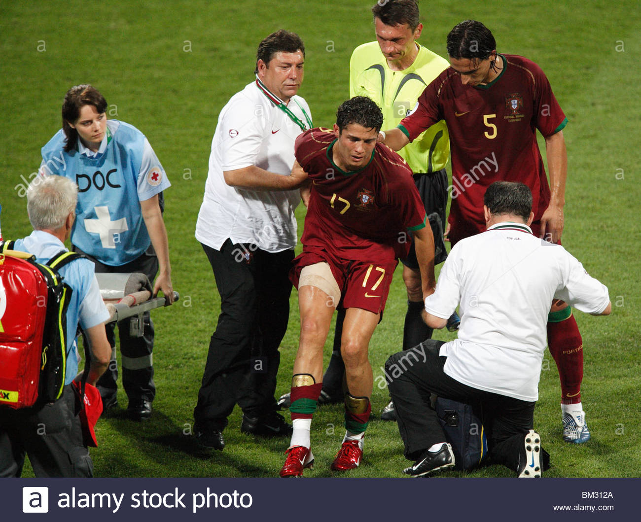 an-injured-cristiano-ronaldo-of-portugal-17-is-helped-of-the-pitch-BM312A