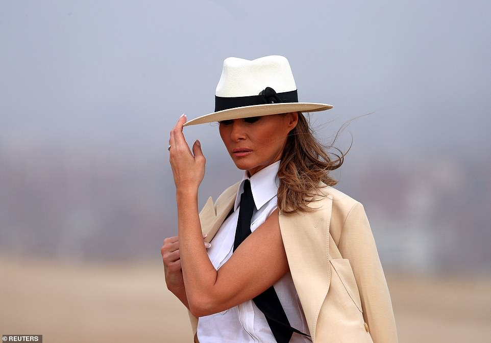 4820374-6247263-The_First_Lady_paired_a_tan_linen_blazer_white_pants_and_Chanel_-a-32_1538842993175