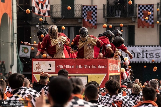 10527032-6766863-A_festival_in_Italy_where_people_throw_oranges_at_each_other_has-a-67_1551649148471