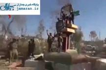 پایین کشیدن پرچم داعش در مرکز تلعفر