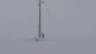 تلاش سیمبانان امور برق چادگان اصفهان در کولاک و سرمای زیر صفر درجه