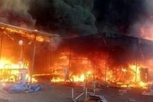 """آتشی که """"نان"""" دستفروشان بازارچه قدیم را سوزاند   از پهن کردن """"سفره خالی"""" مقابل مسئولان تا گرو گذاشتن کارت یارانه"""