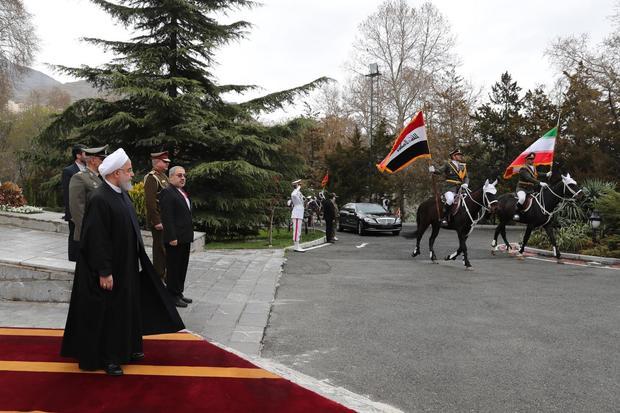 استقبال رسمی رئیس جمهور روحانی از نخست وزیر عراق