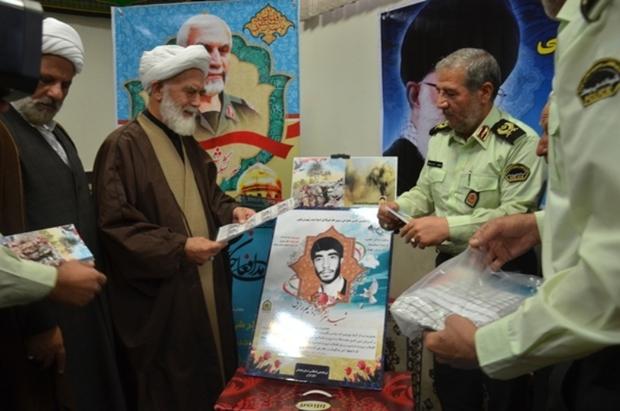 تمبر و کتاب زندگینامه شهید زارعی در همدان رونمایی شد