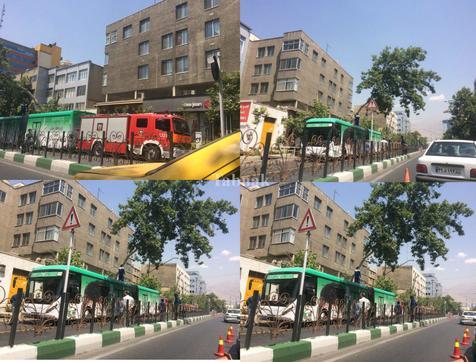 سقوط درخت بر روی اتوبوس بی آر تی در خیابان ولیعصر+ عکس