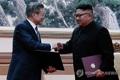 توافق دو کره برای برنامه خلع سلاح اتمی