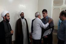 اهدای مدال  جهانی کشتی گیر گتوندی به خانواده شهید مدافع حرم