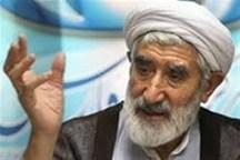 """تجلیل از """" آیتالله دکتر احمدی"""" عضو شورای انقلاب فرهنگی در ملایر"""