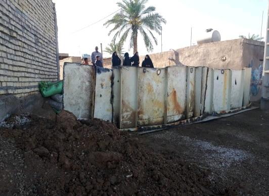 اقدام جهادی بسیجیان نیروگاه رامین اهواز در احداث سیل بند متحرک حاشیه رودخانه کارون