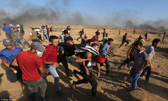 تصاویر/ 2 شهید و دهها زخمی در راهپیمایی بزرگ بازگشت