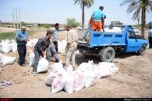 گزارش تصویری سیل بند سازی مجاورت رودخانه بهمنشیر در آبادان