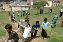 بوستان ورودی شهر جوانرود از زباله پاکسازی شد