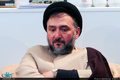 انتقاد ابطحی از حذف تصویر احمدی نژاد در شهر زادگاهش و جایگزینی آن با تصویر روحانی + عکس