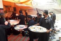 مراسم عزاداری سنتی همراه با سفره پر برکت امام حسین (ع) در هندیجان+ تصاویر