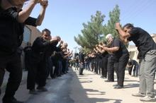 آیین های سنگ زنی و طوق گردانی در روستای اعلاء برگزار شد