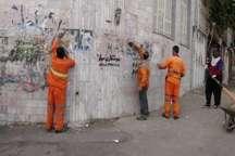 عملیات پاکسازی آثار تبلیغات کاندیداها از سطح شهر سنندج آغاز شد